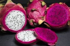 Red and White Dragon Fruit Cut Up on a Cutting Board Royalty Free Stock Images