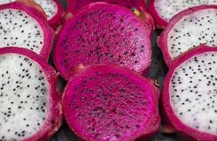 Red and White Dragon Fruit Cut Up on a Cutting Board Royalty Free Stock Image