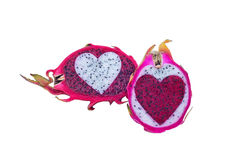 Red and white dragon fruit insert opposite colour of heart shape Royalty Free Stock Photo