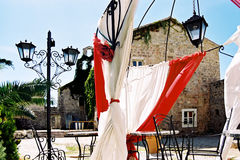 Red and white drapery. Cafe with red and white drapery on the sun Stock Images