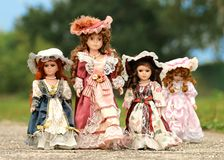 Red and White Dressed Porcelain Doll Royalty Free Stock Photo