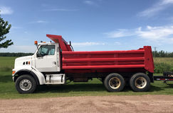 Red and White Dump Truck. Against a blue summer sky Royalty Free Stock Images