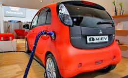 Red and white electric car Mitsubishi Miev Stock Image