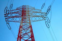 Red and white electricity pylon Stock Photo