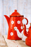 Red and white Enamel Tea Coffee Pots on wood Stock Image