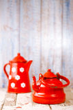 Red and white Enamel Tea Coffee Pots on wood Stock Photography