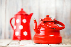 Red and white Enamel Tea Coffee Pots on wood Royalty Free Stock Image