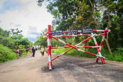 Red-white entrance gate to Chong Arn Ma, Thai-Cambodia border crossing (called the An Ses border crossing in Cambodia) to Ubon Rat. Preah Vihear, Cambodia royalty free stock image