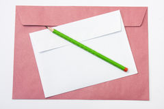Red and white envelopes with a wooden pen Royalty Free Stock Photos