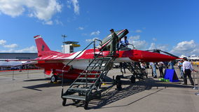 Red and white F-16C Fighting Falcon of RSAF Black Knights on display at Singapore Airshow Stock Photo