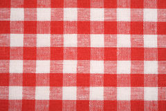 Red and white fabric background. Stock Photo