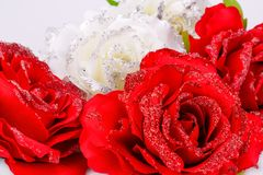 Roses. Red and white fabric roses closeup picture Royalty Free Stock Image