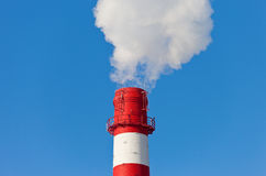 Red and white factory chimney Stock Photo