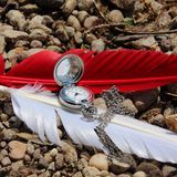 Red and white feather accessories on send Royalty Free Stock Image