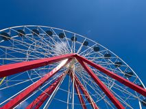 Red White ferris wheel Stock Images