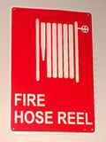 Red on white fire hose reel sign Stock Photos