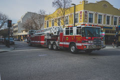 Red and White Firetruck Om Asphalt Road during Daytime Royalty Free Stock Photo