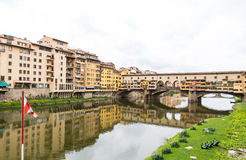 Red and White Flag by Ponte Vecchio Royalty Free Stock Photo