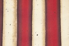 Red and white flag striped background of painted canvas with grunge effect. A Red and white flag striped background of painted canvas with grunge effect Royalty Free Stock Photos