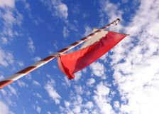 Red white flagpole. In front of blue sky royalty free stock images