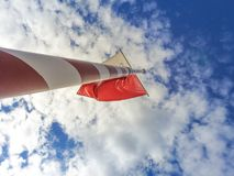 Red white flagpole. In front of blue sky royalty free stock photo