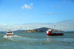 Red and White Fleet boat docking at Pier 43 at Fisherman's Wharf in San Francisco Stock Image
