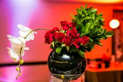 Red and White Flower Display for decor at corporate event. Gala dinner banquet Royalty Free Stock Photography