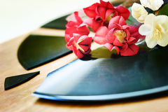 Red and white flowers on a broken record Royalty Free Stock Photo