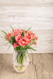 Red and white fluffy tulips in vase on wood Stock Photography