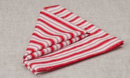 Red White Folded Napkin On Natural Linen Background.  Stock Photo