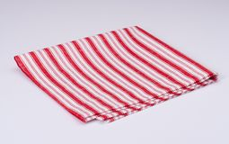 Red White Folded Napkin On White Background.  Stock Photography
