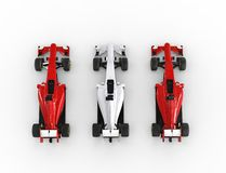 Red and white formula one cars - top view Stock Images