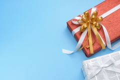 Red and white gift boxes on blue background Stock Photos