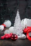 Red and white gifts boxes with ribbon and holiday decoration, ball and toys on a dark background, Christmas greeting card, copy. Space stock photography