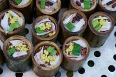 Red and white glutinous rice roasted in bamboo joints. Glutinous rice with a dash of coconut, pandan, soybean and red kidney bean Stock Image
