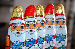 Red White Gold and Blue Santa Claus Carrying Gift Sweets Line Stock Image