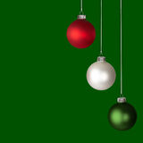 Red, White and Green Christmas Ornaments Isolated. On Green Background Royalty Free Stock Image