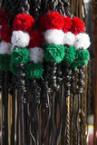 Red white and green colored whips at the farmers market for sale Royalty Free Stock Photos