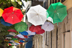 Red, white and green hanging umbrellas Royalty Free Stock Photos