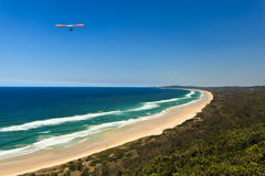 Red and White Hang Glider Above Beautiful Beach Royalty Free Stock Photos
