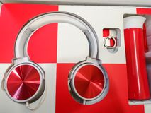 Red-White headphones, headphones as a gift, Multicolored music royalty free stock photos