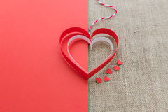 Red and white heart on half of red paper and sackcloth  backgrou Royalty Free Stock Photography
