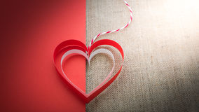 Red and white heart on half of red paper and sackcloth  backgrou Stock Images