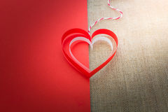 Red and white heart on half of red paper and sackcloth  backgrou Stock Photo