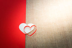 Red and white heart on half of red paper and sackcloth  backgrou Royalty Free Stock Photo