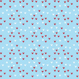 Red and white heart shape pattern on soft blue background Royalty Free Stock Image