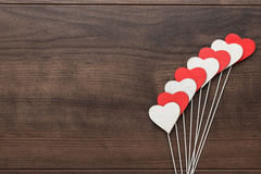 Red and white heart shapes on sticks Royalty Free Stock Photos