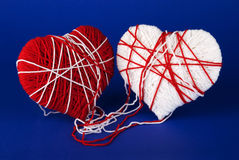 Red and white heart of woolen yarn Royalty Free Stock Photo