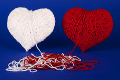 Red and white heart of woolen yarn Stock Image