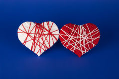Red and white hearts on a blue background Royalty Free Stock Images